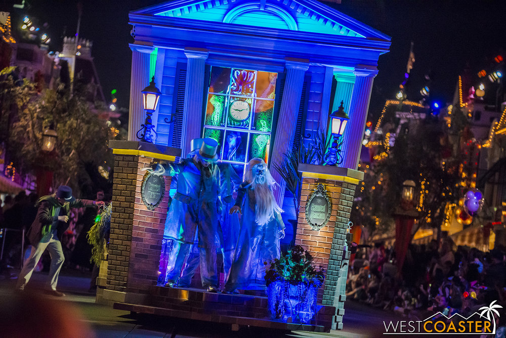 As they part, they reveal the Hitchhiking Ghosts at the front of the float!