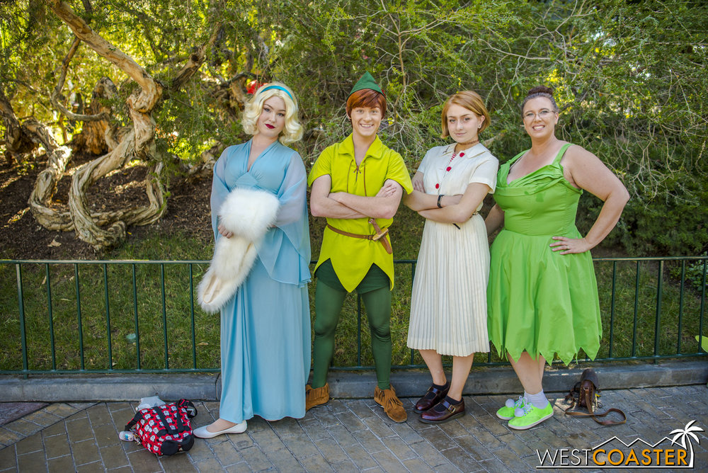 In this assorted Disney character contingent, which one is the actual cast member?