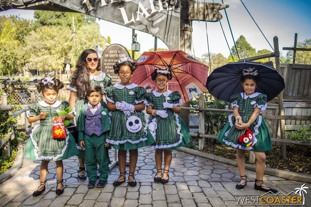 This family of Haunted Mansion hostesses and host were absolutely adorable.