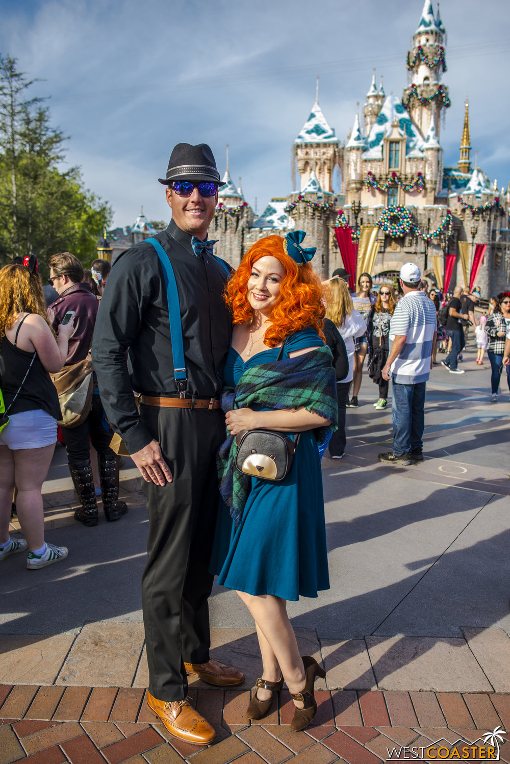 Over in front of Sleeping Beauty Castle, Merida poses with her date.
