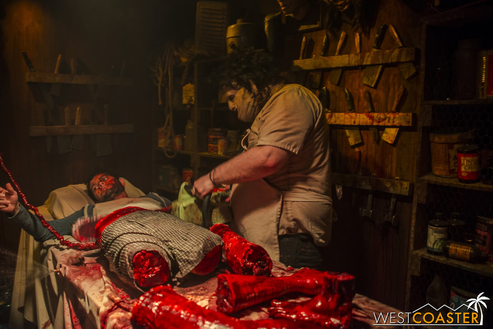 Inside the haunted house, Leatherface is working on arts and crafts.