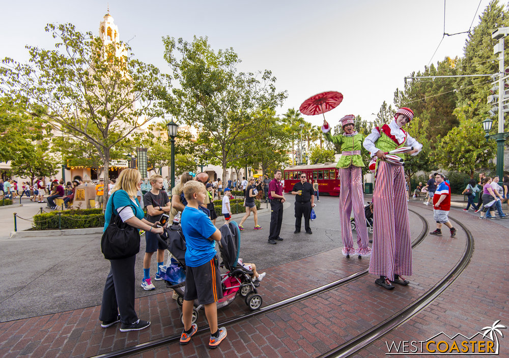 The Stilt Circus troupe interacts with guests inside the park.
