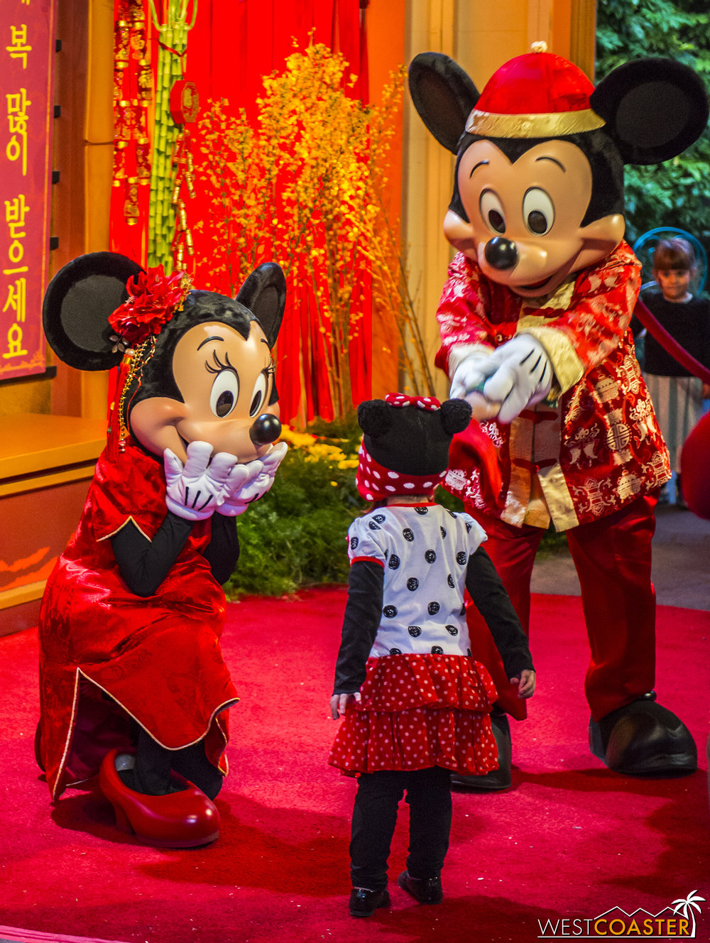 Mickey and Minnie are pleased to meet their adorable guest.