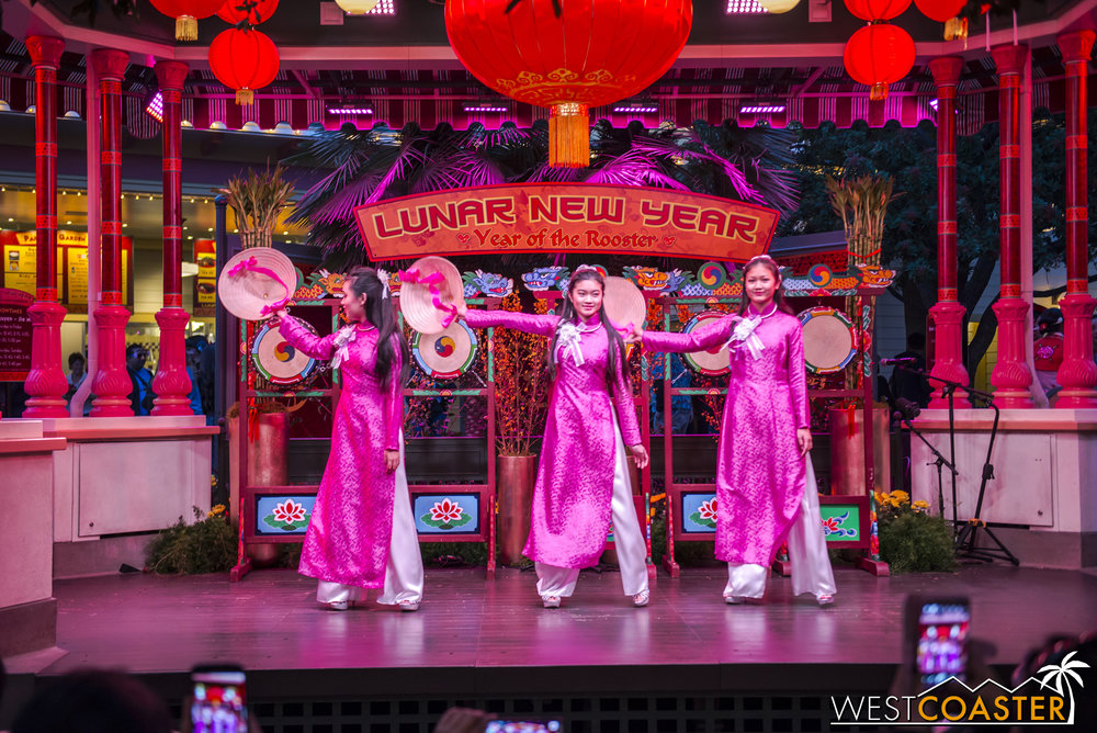 Three young ladies perform a Vietnamese hat dance.