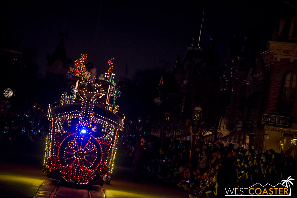 The Main Street Electrical Parade begins with the recognizable Casey Jr. Train chugging down the street.