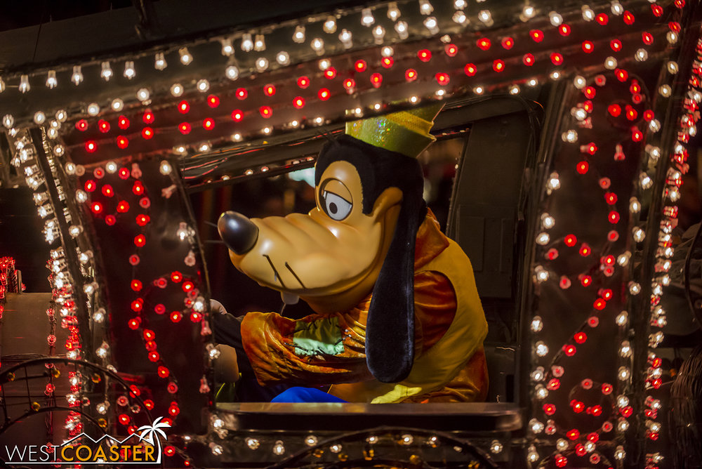 Conductor Goofy cheerfully steers the parade true.