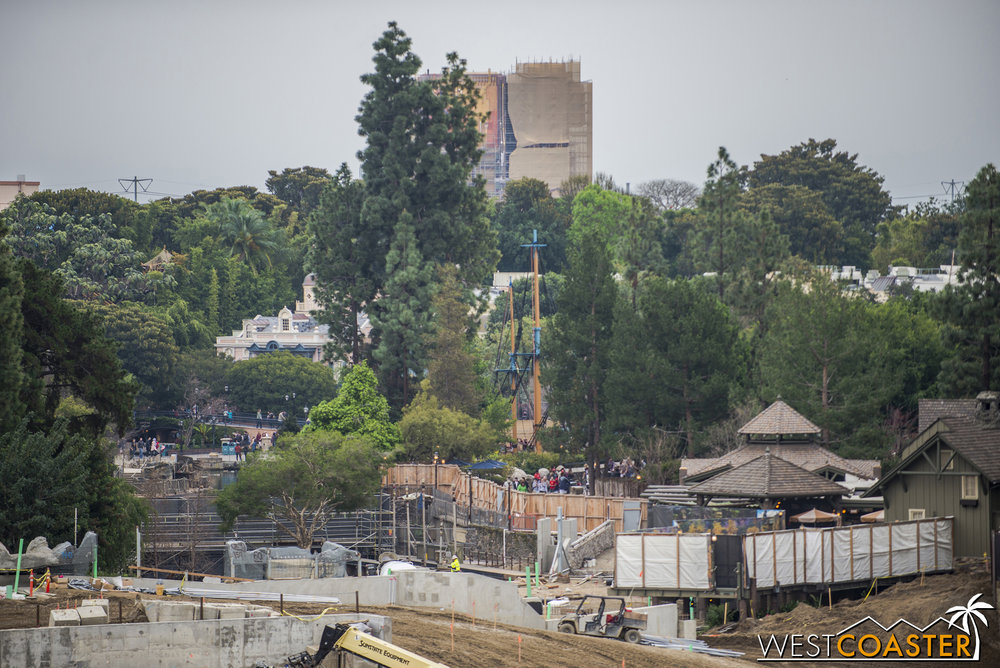 "You can see the backside of the temporary dam on the Rivers of American on the left half of this photo, above the ""Sunstate Equipment"" lift and behind that branchy looking tree."