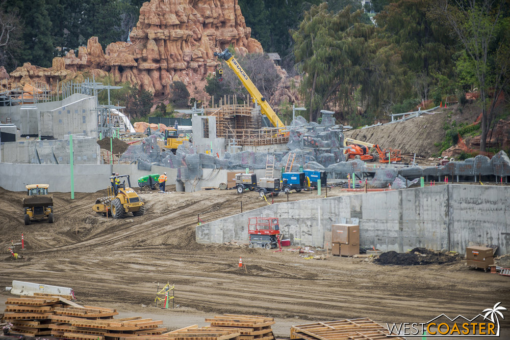 "Here, you can see the mesh wrapping around to the ""Star Wars"" Land facing side, with numbers spray painted to identify components of the future rocky surface."