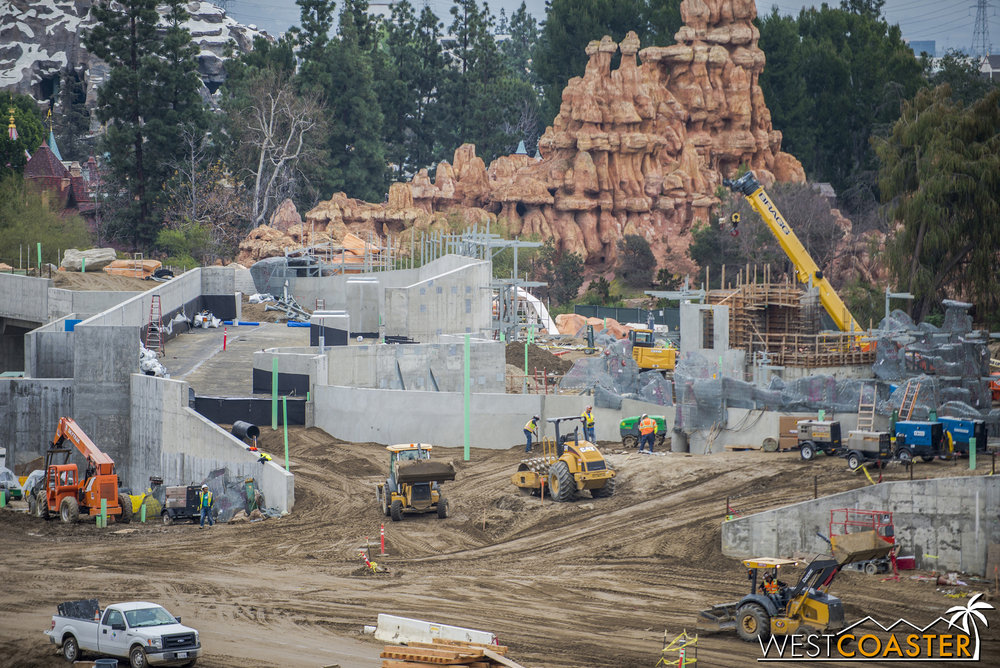 "In addition, there looks to be a bit of a bridge over one of the future entry portals of ""Star Wars"" Land, presumably to provide service access and connect from backstage of Fantasyland/Frontierland.  This looks similar to a  service crossing at Mysterious Island at Tokyo Disney Sea  that is masked by a tunnel from the park guest perspective."