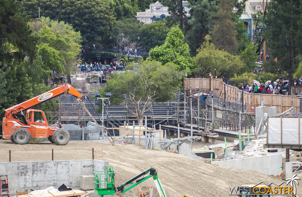 "This is purely my own speculation, but said bridge/pathway might be the back entrance into ""Star Wars"" Land, angling along the reconfigured bank of the Rivers of America briefly before crossing over or under the Disneyland Railroad to enter Star Wars Land en proper."