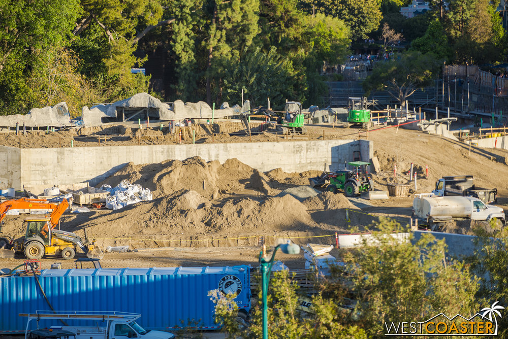 Back along the Rivers of America, the rockwork slowly continues.