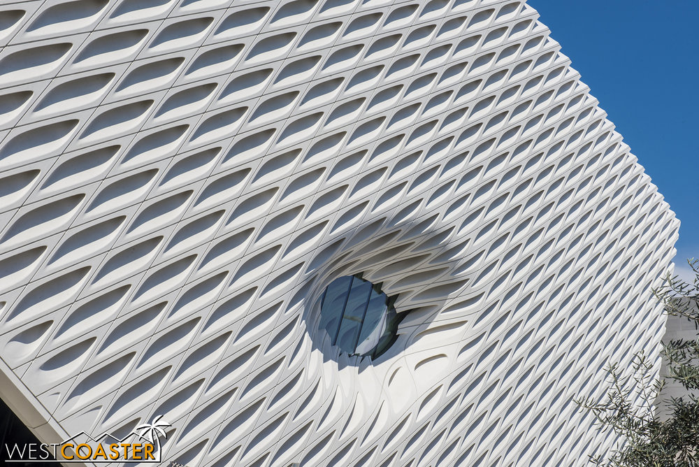 Looking up at the building facade and oculus.
