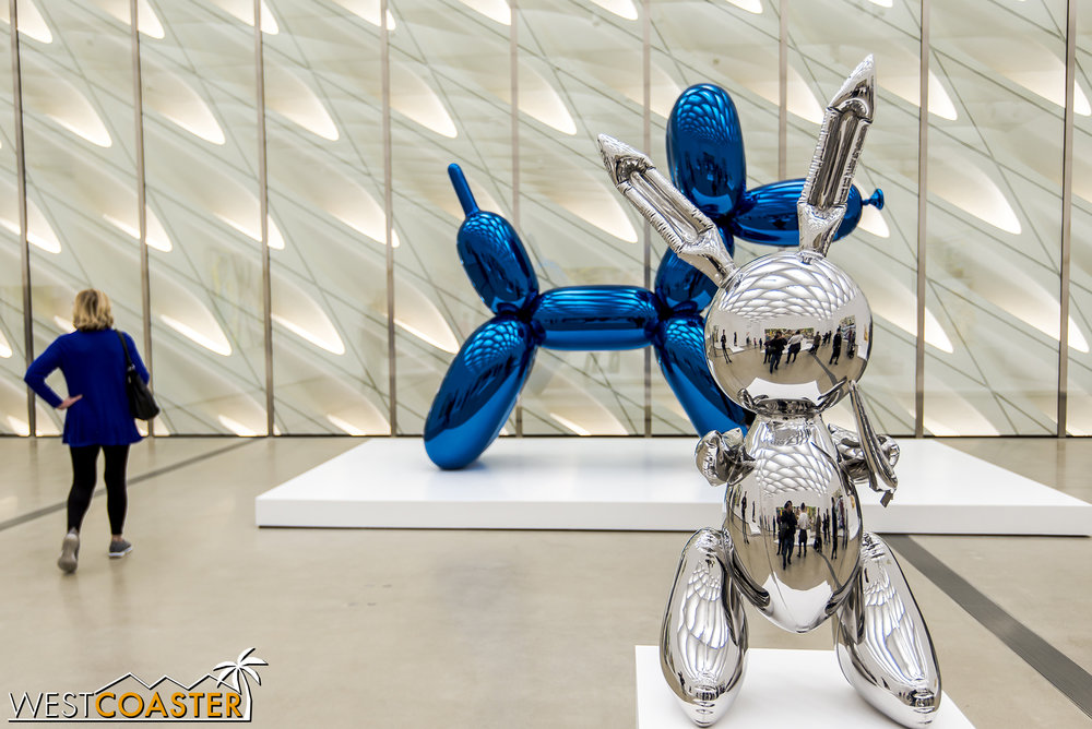 Jeff Koons'  Balloon Dog (Blue) , along with his  Rabbit  in front.