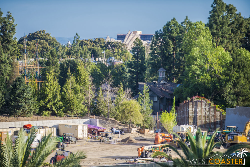 "Over at the Hungry Bear side, any visibility of progress on the ""back"" entrance into ""Star Wars"" Land has been obscured by all those dang trees they've added to the raised berm that separates the Rivers of America from ""Star Wars"" Land."