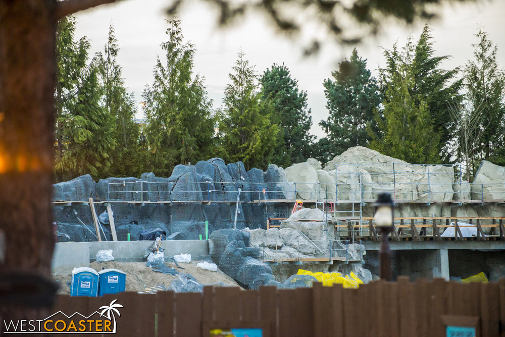 A glimpse over the work walls by Critter Country shows more progress on the rockwork.