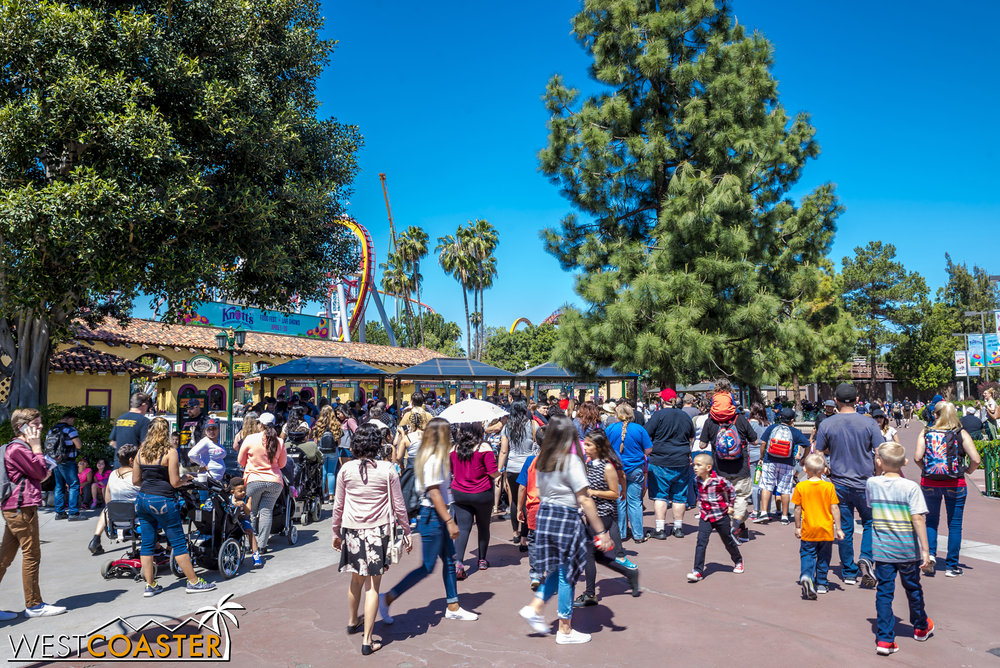 There are three banks of metal detectors on each side of the entrance plaza, each with two metal detectors, for a total of twelve detectors--each with its own bag station (I'm looking at you, Disney)--to screen guests.  And they're under permanent structures!  If Knott's could do this in a few weeks, there's no reason Disney couldn't.