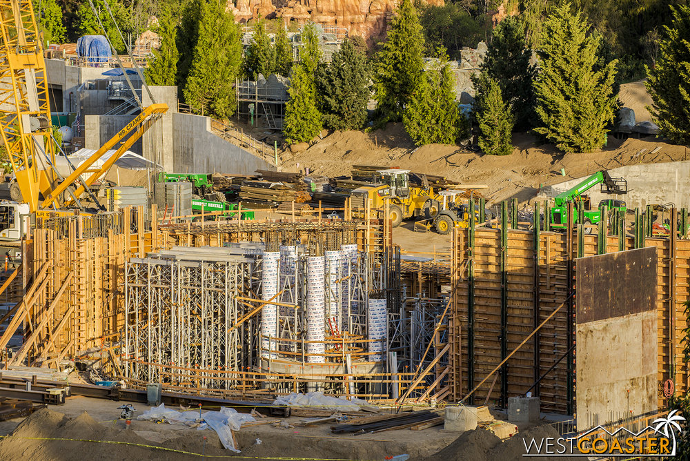 There's tons of scaffolding, formwork for what appear to be round, concrete columns, and more formwork for concrete walls that are pretty tall!  Whether this will be the ride loading area, some Circlevision-style part of the queue, or a part of the ride itself, I don't know. But it's fun to speculate!