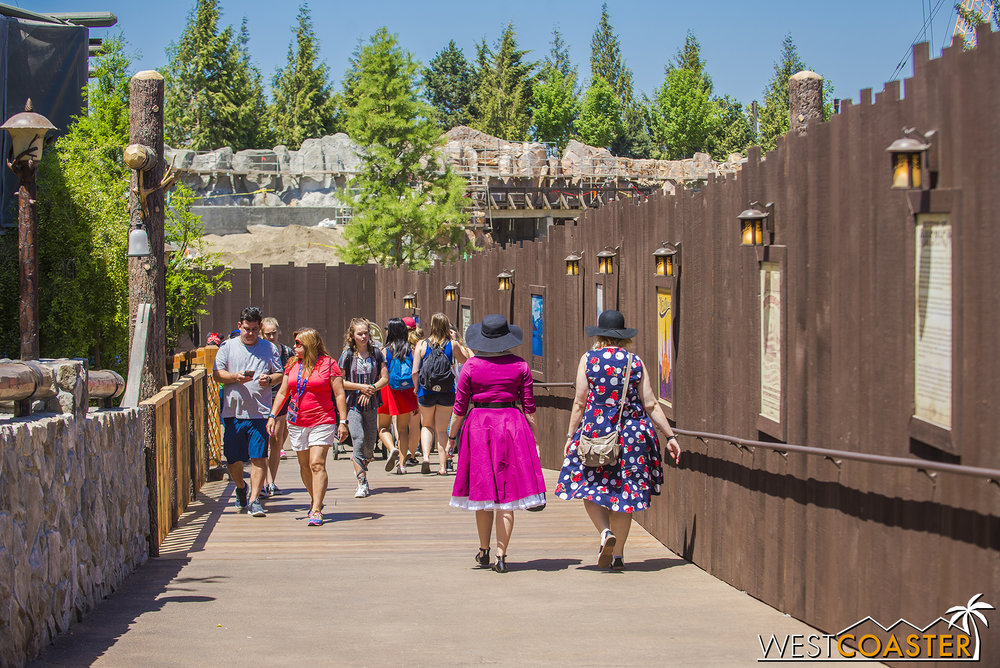 "And here you see the walkway to the lower level of the Hungry Bear.  Well, there's about twice this width on the other side of the wall, and that will continue to slope down toward the waterfront along this route, then turn left and duck under the railroad before coming back up on the ""Star Wars"" Land side."