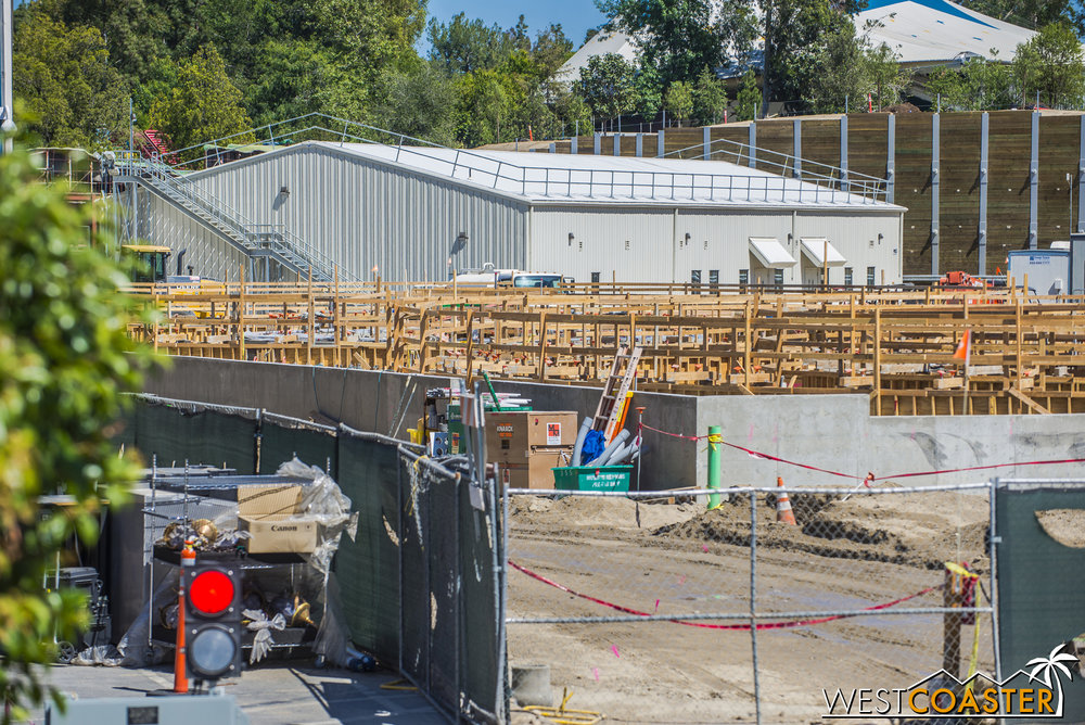 The waist to chest height concrete along the outside is the ultimate footprint of the building, but the circular formwork seems to be creating interior concrete walls for the ride enclosure.