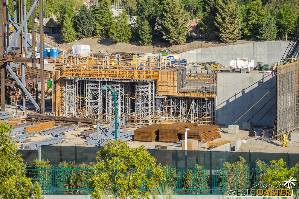 Additional formwork and supporting scaffolding continues to go up around what used to be the big, round pit.