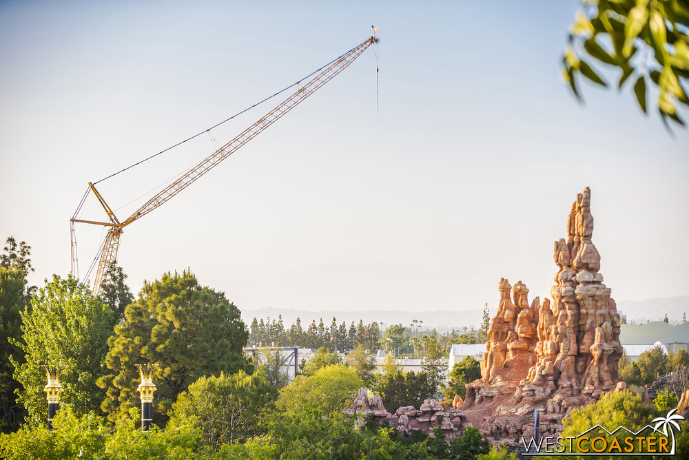 Expect cranes to be in the Disneyland skyline for the foreseeable future.  Too bad they can't dress this on up like a Malificent and incorporate it into FANTASMIC! 2.0...