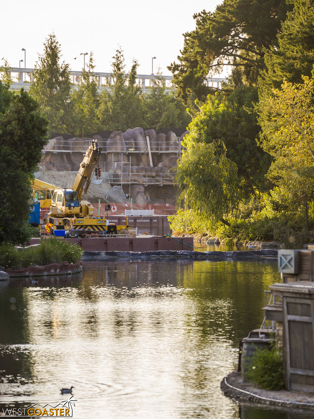 Here's a better angle of the Rivers of America on both sides of the dam--now both watery again!