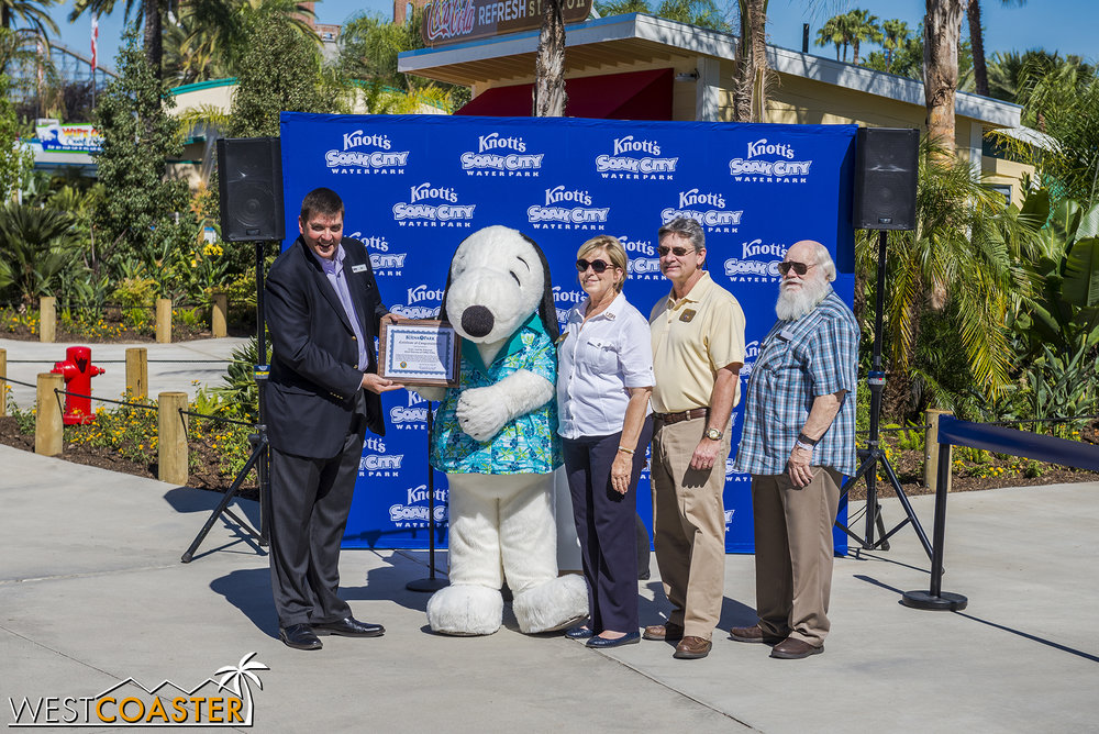 "Snoopy joins in accepting the honorary plaque for Soak City's ""re-opening,"" highlighted by the new expansion."