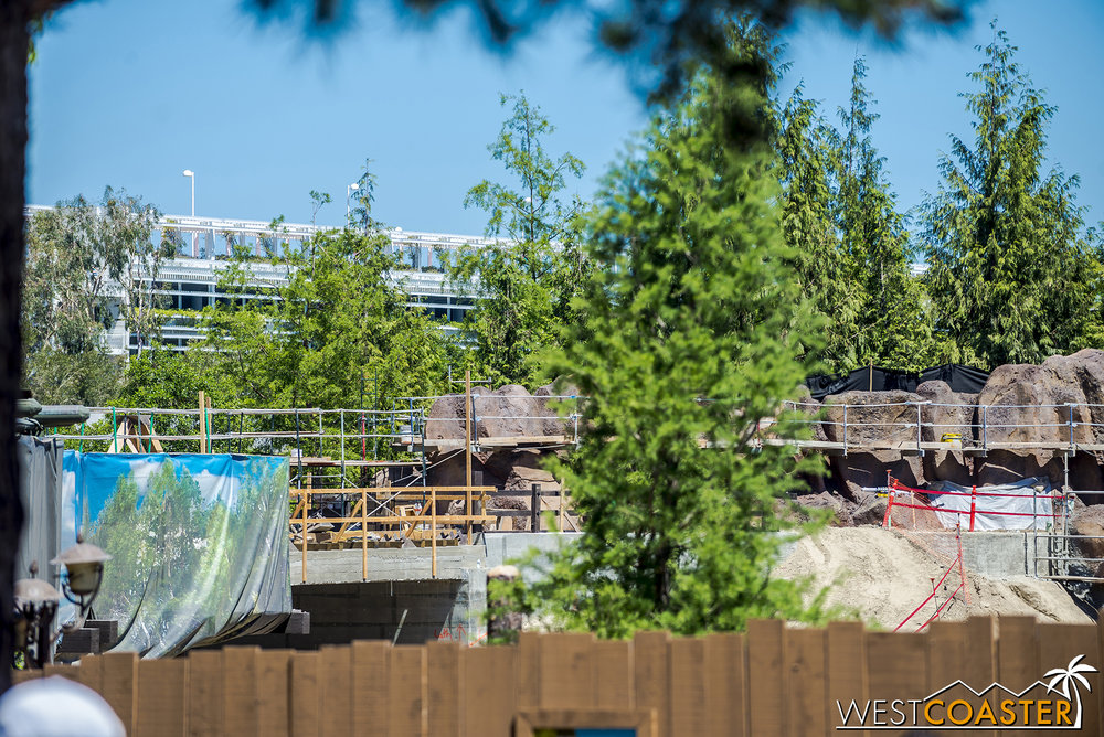 "The concrete just beside the tarp on the left is part of the bridge over the tunneled entrance that will lead guests walking along the Rivers of America waterfront beside the Hungry Bear Restaurant into the future ""Star Oars"" Land."