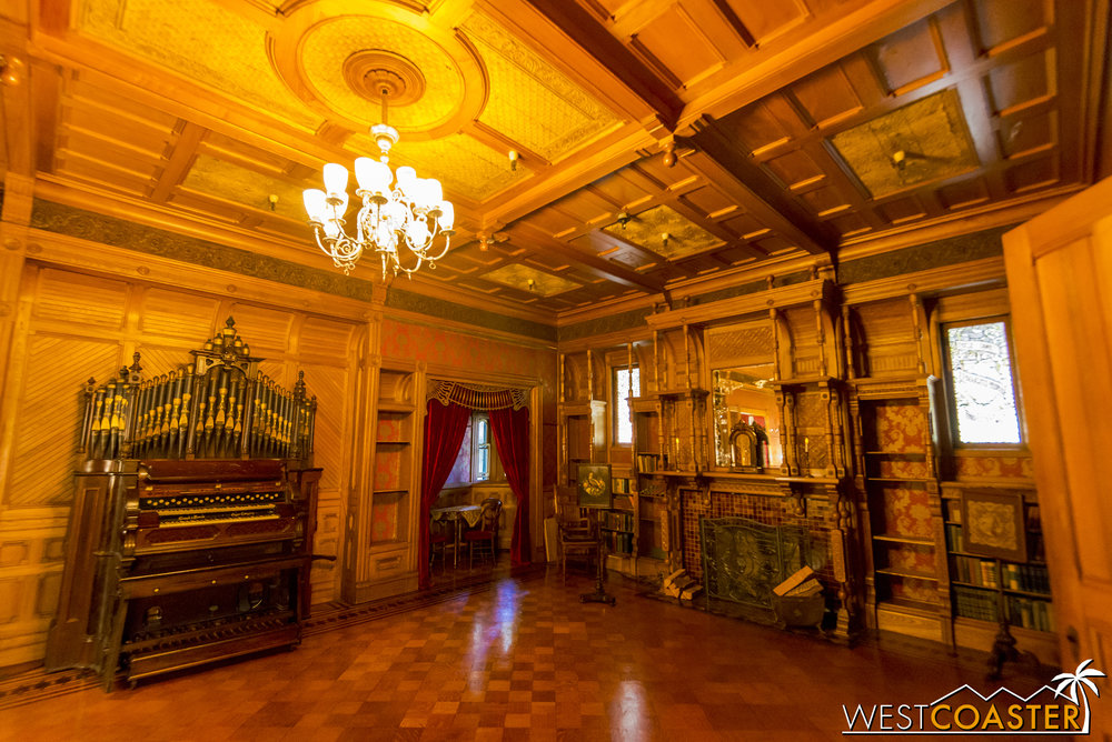 One of the grandest spaces in the house is the ballroom, which is filled with luxurious furnishings.
