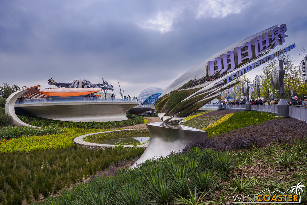 The sleek signage for Tomorrowland beckons.  Jet Packs take flight in the background.