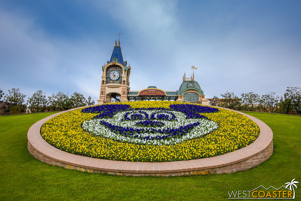 The prerequisite Mickey Mouse floral greets guests into the park.