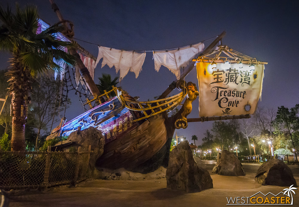 A shipwreck marks the entrance into Treasure Cove from Fantasyland.