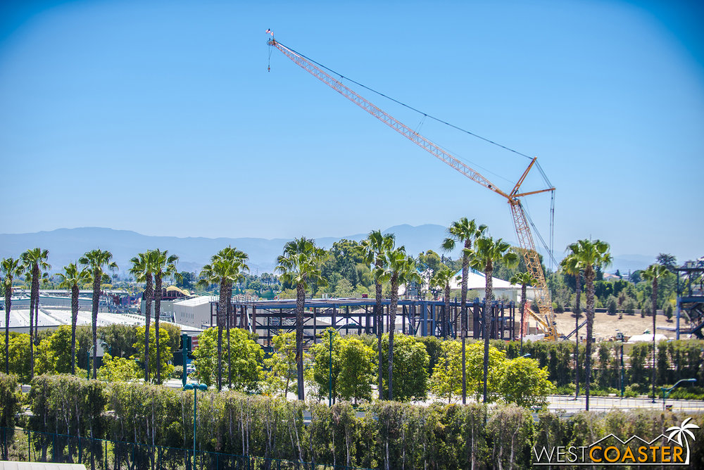 Moving towards Mickey's Toontown, we see that the Millennium Falcon building has grown too.