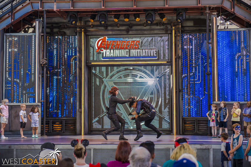 Black Widow demonstrates some combat skills with one of the agents.