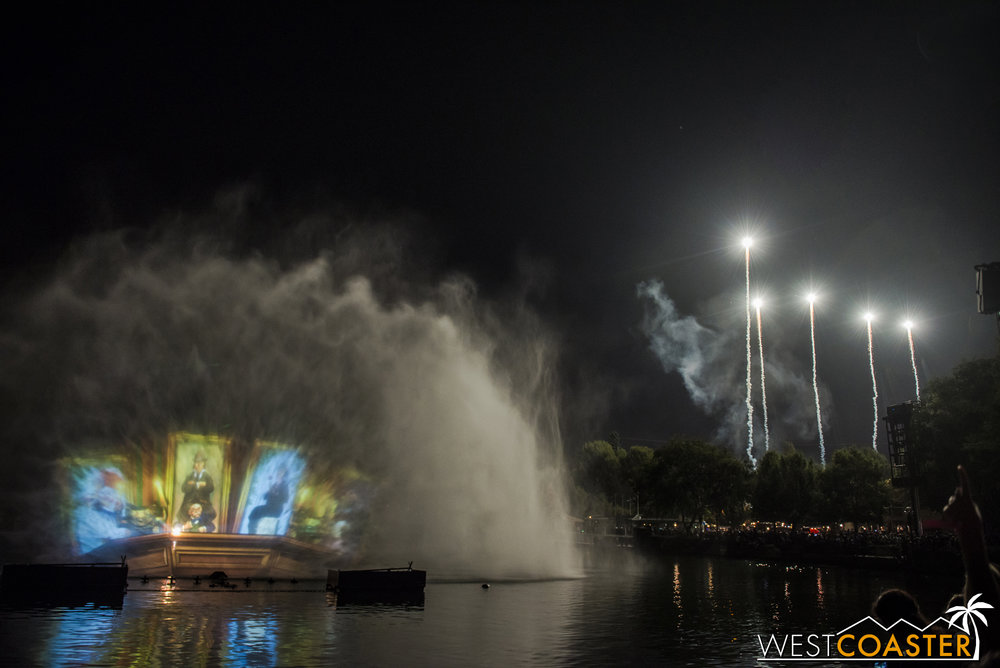 Spectral bursts light up the The Hub beyond during the Haunted Mansion segment of Remember...