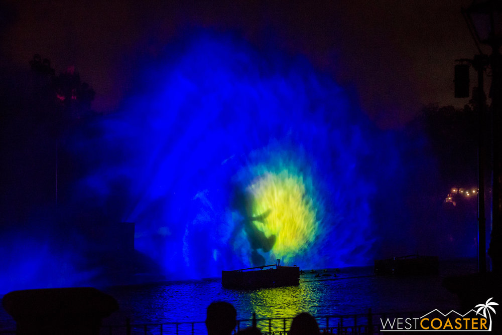 Mickey appears on the projection screens, plunging into the water, segwaying into a  Little Mermaid  /  Finding Nemo  interlude.