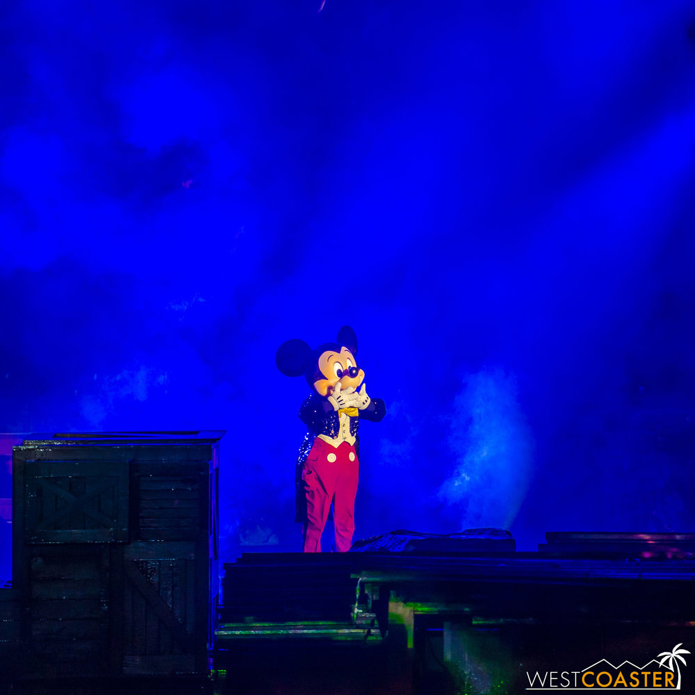 "And with that recognizable Mickey Mouse ""aw shucks"" chuckle, he disappears, capping off the show."