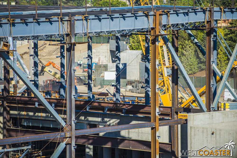 A glimpse through the tangle mass of steel shows not a ton of change on the Rivers of America berm side.