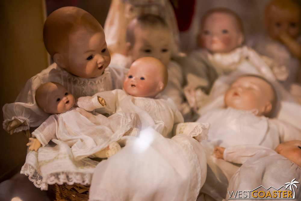 If you're not creeped out enough, here's a baby doll holding a baby doll with another baby doll...