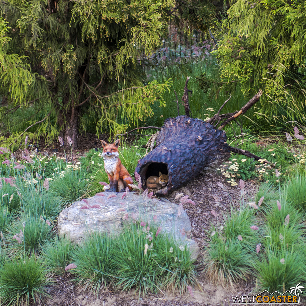 How cute!  A little fox and a baby inside a fallen and hollowed out tree trunk!