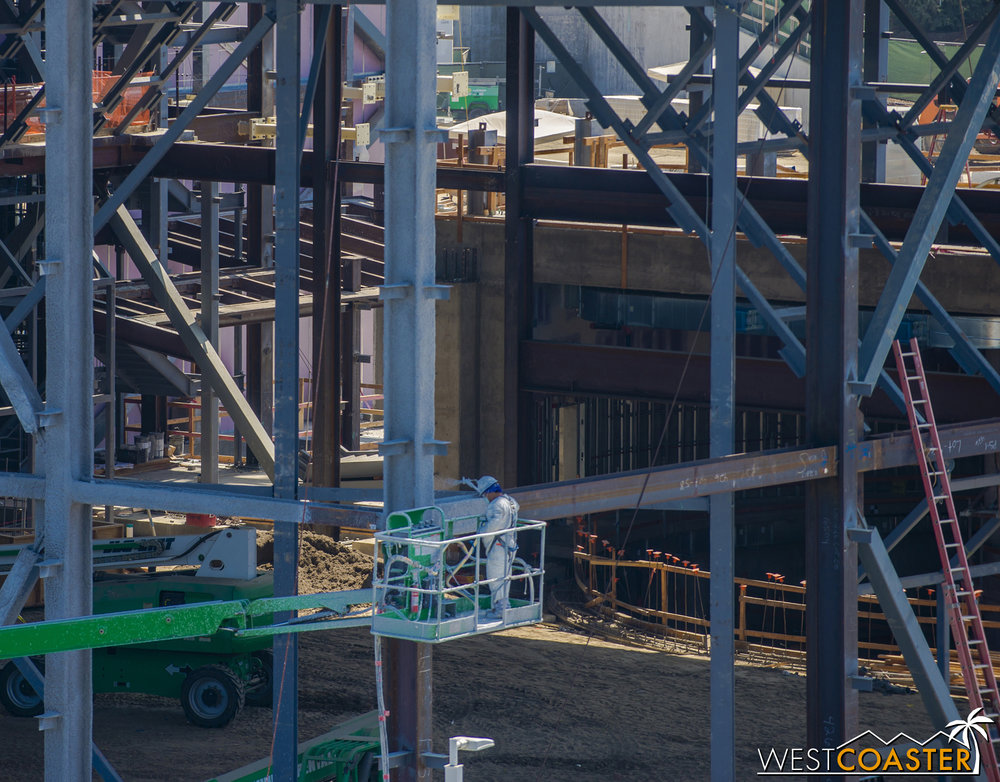 Peeking through the steel, we can see into what used to be an open pit.