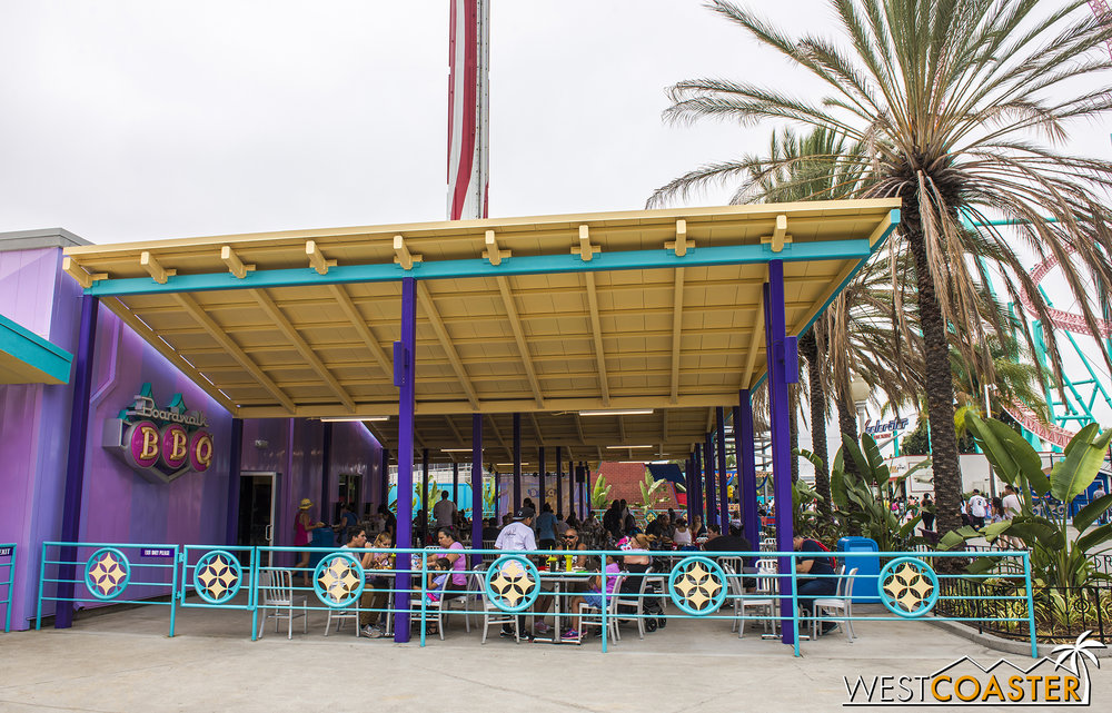 Chevron canopies form the outdoor dining area.