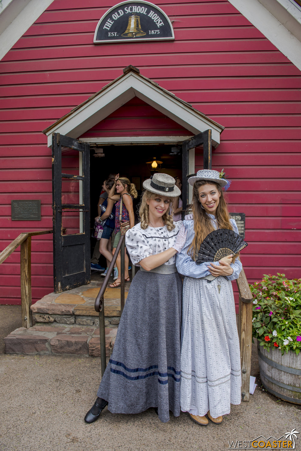 Schoolteacher Abbie McBride (left) and Miss Sierra pose outside the Calico Schoolhouse.