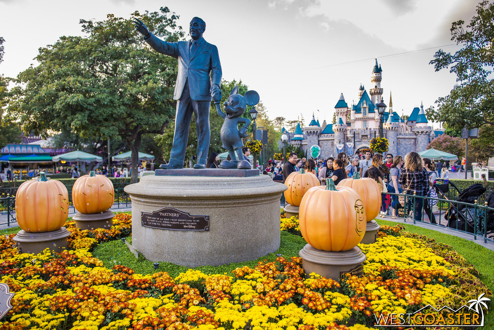 Walt, Mickey, and their pumpkins.
