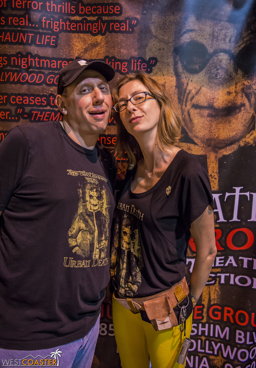 Tour of Terror creators Zombie Joe and Jana Wilmer pose in front of the show banner.