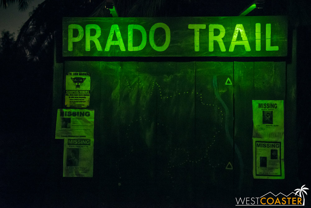 An eerie, green-lit sign marks the start of the Prado Witch Trail.  Missing children's posters identify various Decayed Brigade members, similar to how Tooth Fairy features certain Knott's Scary Farm associates in the missing children's posters in its maze.