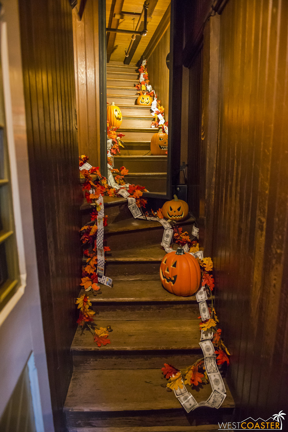 The famous stairway to nowhere is decorated with tarot cards and jack-o-lanterns for Halloween.