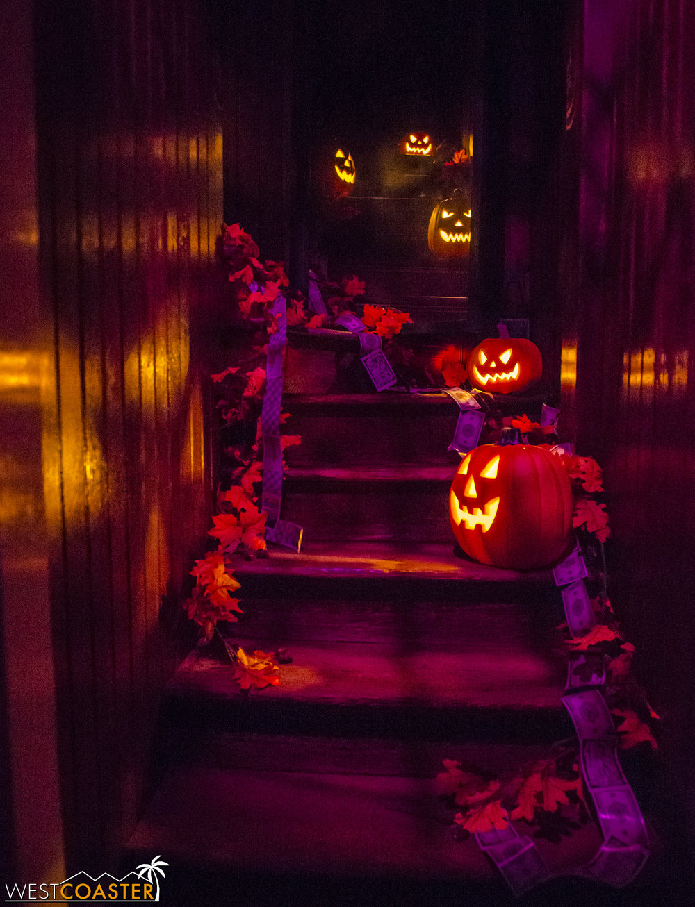 "The ""stairway to nowhere"" glows with jack-o-lanterns at night."