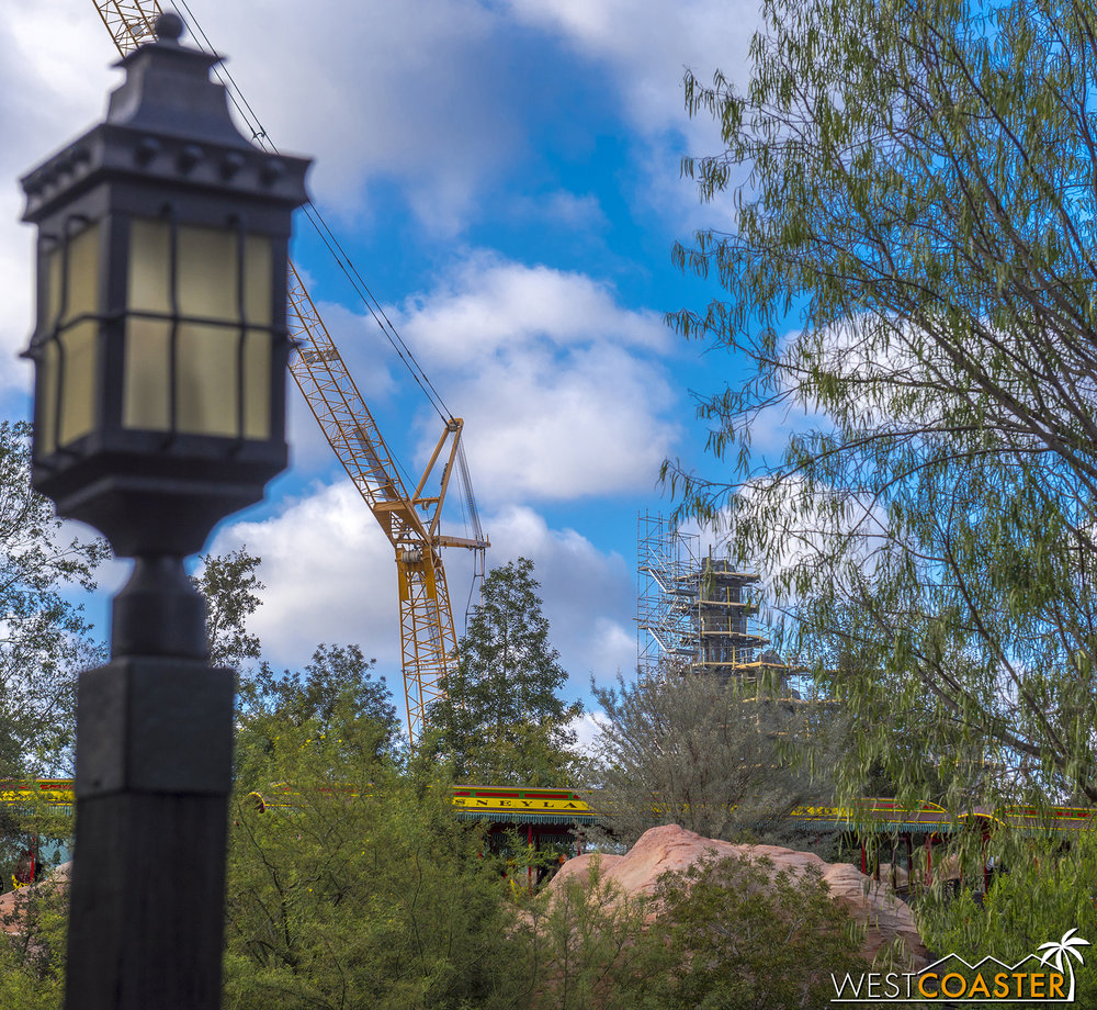 The rock towers are mainly visible when coming from Fantasyland.