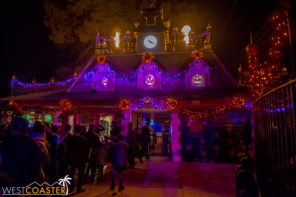 Guests gather at the dramatic, flame-lit entrance of the Ghost Train.